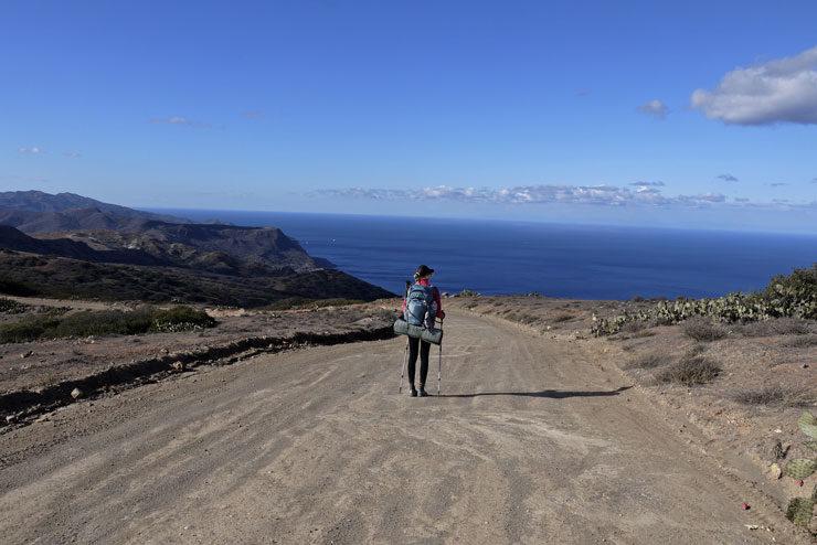 A backpacker hiking thru Trans-Catalina Trail