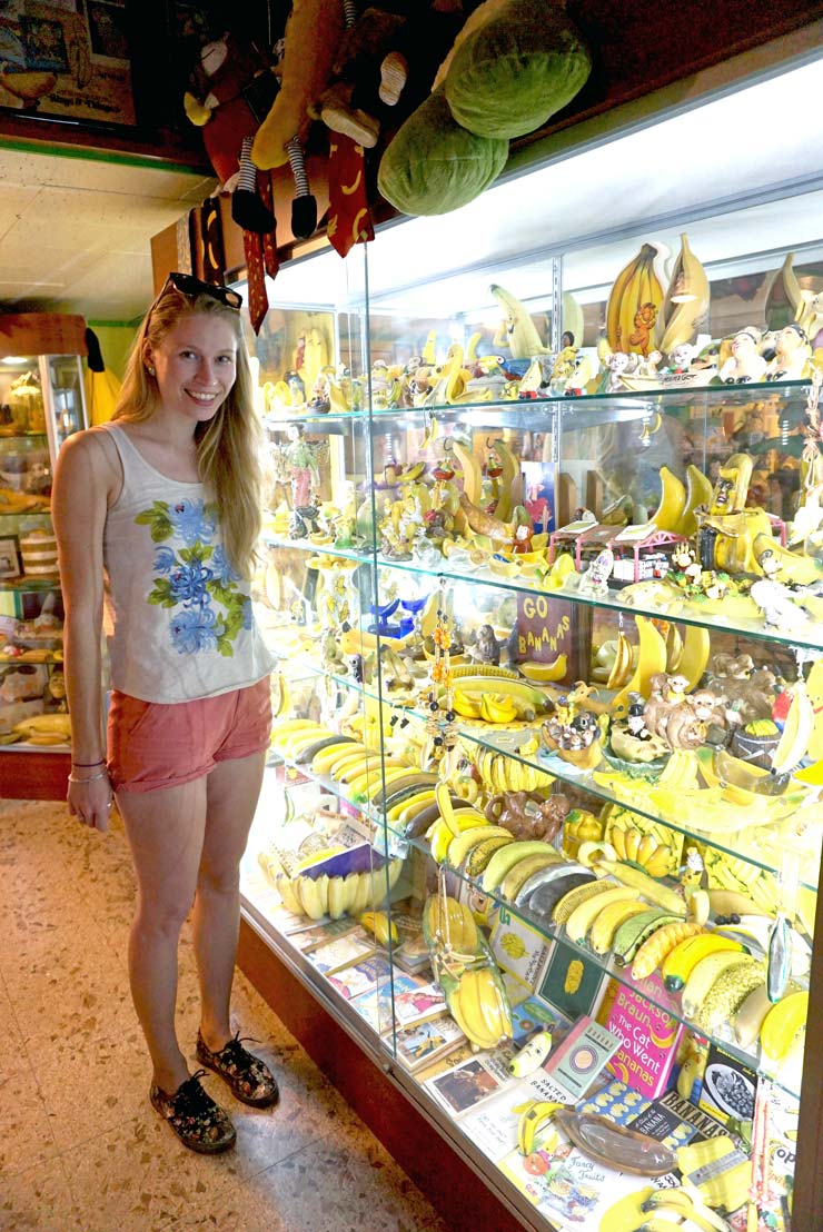 Girl standing by a shelving unit with banana items