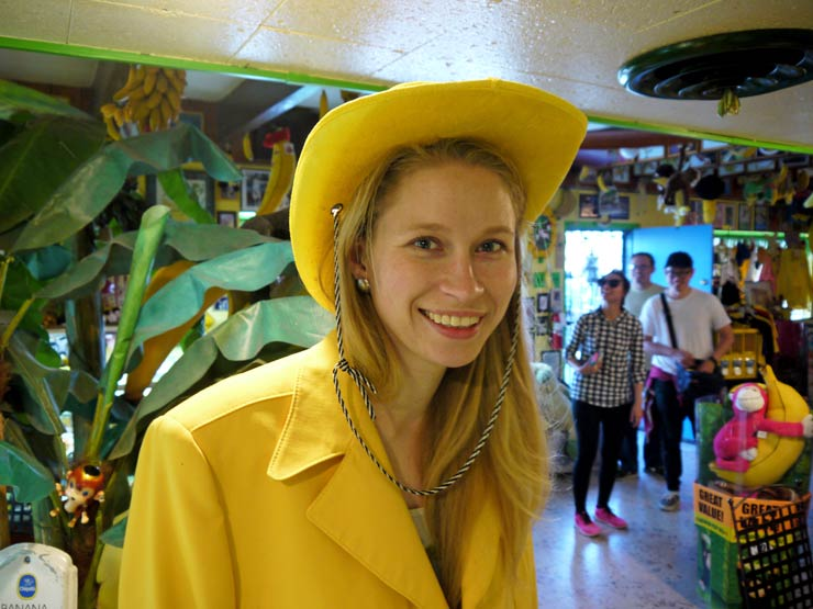 Girl wearing yellow hat and jacket